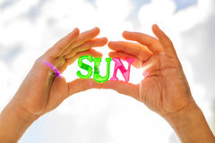 Holding sun in hands. stock photo