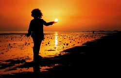 Holding The Sun Royalty Free Stock Image