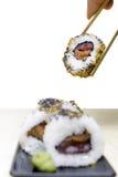 Holding sushi Stock Image