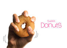 Holding a sweet donut isolated on white background with clipping Stock Photos