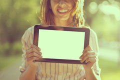 Holding tablet Stock Photos