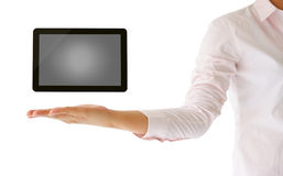 Holding tablet computer in her hand. On white background Royalty Free Stock Photos