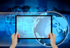 Holding tablet computer in her hand. Holding tablet computer in his hand on abstract the world technology Stock Photo