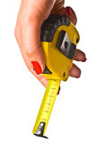 Holding tape measure Royalty Free Stock Images