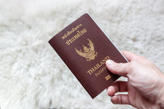 Holding Thai passport Royalty Free Stock Photography