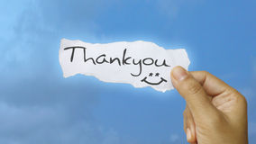 Holding thank you message note. Thank you message concept in raster format royalty free illustration