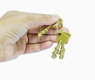 Holding three brass keys by hand Stock Photography