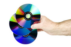 Holding three cds in hand. Isolated on white background Stock Photography