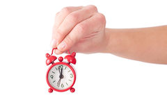 Holding a tiny alarm clock Royalty Free Stock Images