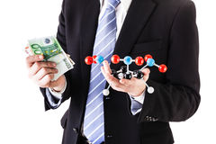Holding a tnt molecule and money Royalty Free Stock Image
