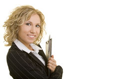 Holding on to a clipboard. Blonde business woman holding a clipboard royalty free stock images