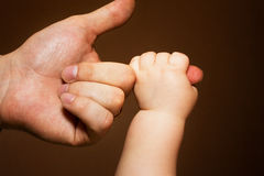 Holding on to Daddy Royalty Free Stock Photo