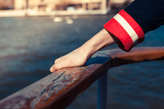 Holding on to the rail onboard a ship Stock Image