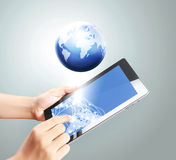 Holding touch screen tablet Royalty Free Stock Images