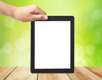 Holding touch screen tablet Stock Image