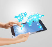 Holding touch screen tablet and shows tablet Stock Photography