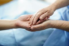 Holding Touching hands Asian senior or elderly old lady woman patient with love, care, helping, encourage and empathy at nursing h royalty free stock image
