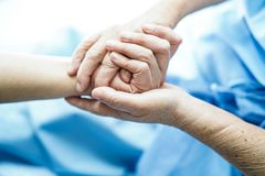 Holding Touching hands Asian senior or elderly old lady woman patient with love, care, helping, encourage and empathy at nursing h stock images