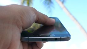 Holding Touchscreen Device, Close-up of female hands using a smart phone stock footage