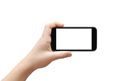 Holding touchscreen smartphone. Hand holding big touchscreen smart phone, clipping path Royalty Free Stock Image