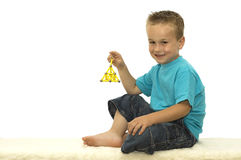 Holding a toy. Boy holding a toy. He is proud that he made this Royalty Free Stock Photography