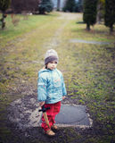 Holding a toy sword. Glum boy holding a toy sword in his hand Royalty Free Stock Photography
