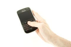 Holding trackball of BlackBerry Bold 9000 Royalty Free Stock Images