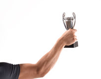 Holding trophy cup. Sport man celebrating holding a trophy cup royalty free stock photo