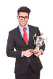 Holding a trophy and smiling Stock Photo