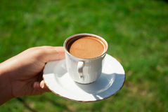 Holding Turkish coffee Royalty Free Stock Images