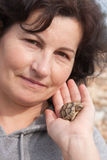 Holding a turtle Stock Image