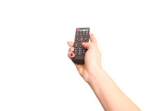 Holding TV remote control Stock Images