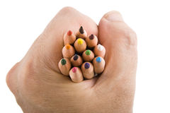 Holding twelve colored pencils Stock Photography