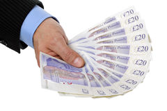 Holding twenty pound notes Royalty Free Stock Image