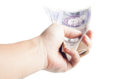 Holding twenty pound notes Royalty Free Stock Photography