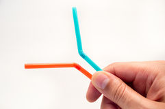 Holding two straws Royalty Free Stock Images