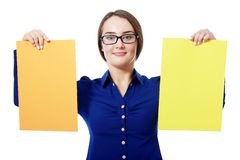 Holding two yellow paper cards Royalty Free Stock Image