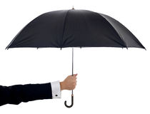 Holding umbrella Stock Images