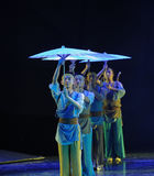 Holding an umbrella team-The dance drama The legend of the Condor Heroes. In December 2, 2014, a large Chinese dance drama the legend of the Condor Heroes for Stock Image