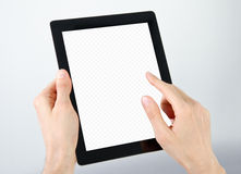 Holding und Punkt auf elektronischem Tablette PC Stockbilder
