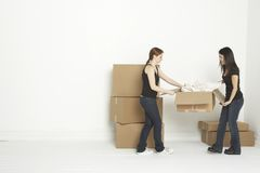 Holding unpacked box Stock Images