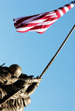 Holding up the American flag 04. A statue of the men on Iwo Jima holding up the flag royalty free stock photography