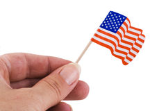 Holding up the american flag. Royalty Free Stock Images