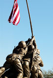 Holding up the American flag. A statue of the men on Iwo Jima holding up the flag stock photo