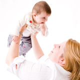 Holding up the baby Royalty Free Stock Image