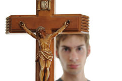 Holding up Crucifix Stock Images