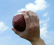 Holding up a Football Stock Photos