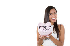 Holding up a piggy bank Stock Images