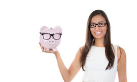 Holding up a piggy bank Stock Image