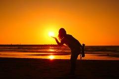 Holding up sunset Stock Image
